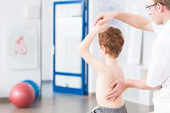 Taking care of child's spine Stock Photos