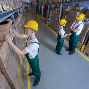 Plant workers during their work in warehouse Kuvituskuvat