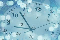 Clock face and calendar composite on blue abstract circles background Stock Photos