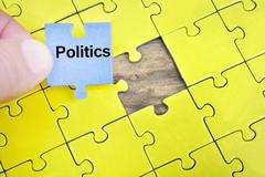 Puzzle with word Politics Stock Photos