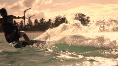 SLOW MOTION CLOSEUP: Extreme kiter girl kiteboarding fast and splashing water Stock Footage