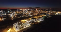 Excellent aerial over huge industrial oil refinery at night. Stock Footage