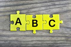 Puzzle with word ABC Stock Photos