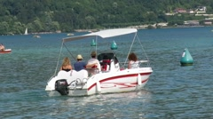 Speedboat slowly on lake annecy Stock Footage