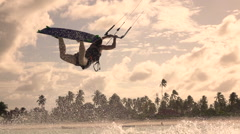 SLOW MOTION CLOSEUP: Extreme kiter woman kitesurf jumping superman at sunset Arkistovideo