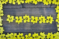 Puzzle with word Update Stock Photos