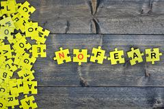 Puzzle with word No fear Stock Photos