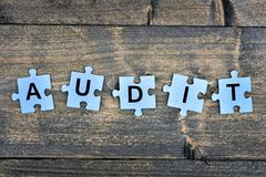 Puzzle with word Audit Stock Photos