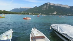 Small boats laying at the lake of Annecy France Stock Footage