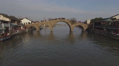 Aerial shot flying underneath traditional old style bridge Stock Footage