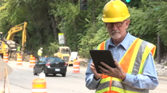 Bill at construction site, wide shot Stock Footage