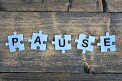 Puzzle with word Pause Stock Photos