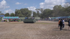 Riding Tank With Children on the Roof and Armored Vehicle Behind Stock Footage