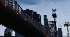 Evening Shot of Roosevelt Island Tram Next to Queensboro Bridge Stock Footage