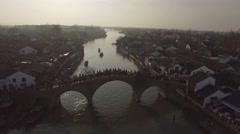 Aerial shot of old style bridge full of people in Zhujiajiaozhen Stock Footage