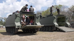 Children and Their Parents go Out From the Armored Vehicles Tanks Door Hatch. Stock Footage