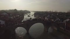 Aerial shot of busy bridge with people in Zhujiajiaozhen Stock Footage