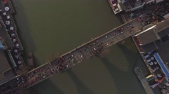 Over head shot of old style bridge full of people Stock Footage
