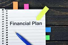 Financial Plan word on notepad Stock Photos