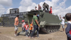 Slow-Mo Children and Their Parents go Out From the Armored Vehicles Tanks. Stock Footage
