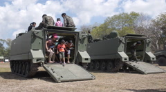Slow-Mo Children and Their Parents go Out From the Armored Vehicles, Tanks Thru Stock Footage