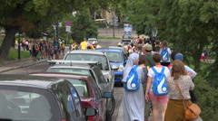 WYD Krakow 2016 - crowd with nuns walking in a street with tree -  slow motion Stock Footage