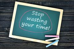 Stop wasting your time text on school board Stock Photos