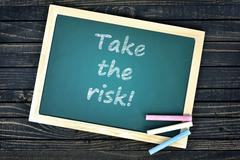 Take the risk text on school board Stock Photos