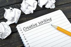 Creative Writing text on notepad Stock Photos