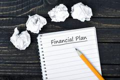 Financial Plan text on notepad Stock Photos