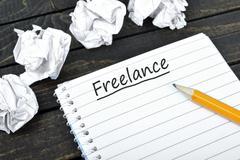 Freelance text on notepad Stock Photos