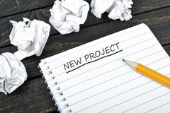 New project text on notepad Stock Photos