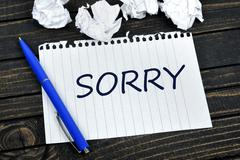 Sorry text on notepad Stock Photos