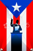 Puerto Rico flag with political speaker behind a podium - stock photo