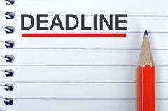 Deadline text on notepad and pencil Stock Photos