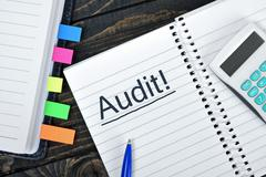 Audit text on notepad Stock Photos