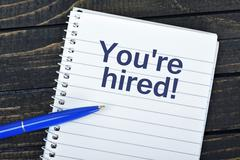 You're hired text on notepad Stock Photos