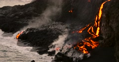 Volcanic Eruption Lava flowing into the water Hawaii Stock Footage