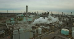 Excellent aerial over huge industrial oil refinery with smoke and pollutants Stock Footage