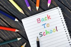 Back To School text on notepad Stock Photos