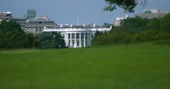 White House Rack Focus with Grass from Capital Mall Washington DC Stock Footage