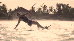 SLOW MOTION CLOSE UP: Cheerful kiter girl kiteboarding and splashing water Stock Footage