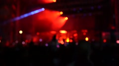 Silhouettes of concert crowd in front of stage Stock Footage