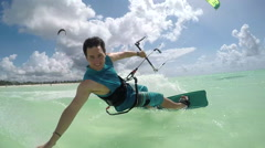 SLOW MOTION: kite surfer kiteboarding and doing hand drag splashing water Stock Footage