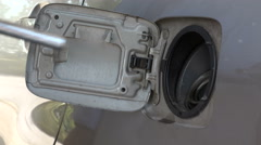 Man pumping gas into gas tank, close up shot Stock Footage