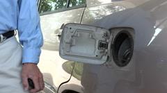 Man pumping gas into gas tank Stock Footage