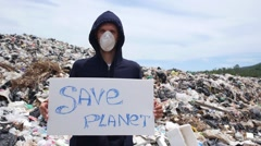 Environmental Problems - Man on Landfill Site with Save Planet Slogan Stock Footage
