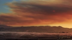 Pan across smoke from wildfire in Central California at sunset. Timelapse Stock Footage