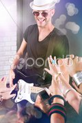 Guitarist performing for his adoring fans - stock photo