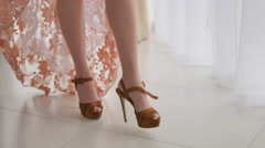 Woman heeled walking on the white floor Stock Footage